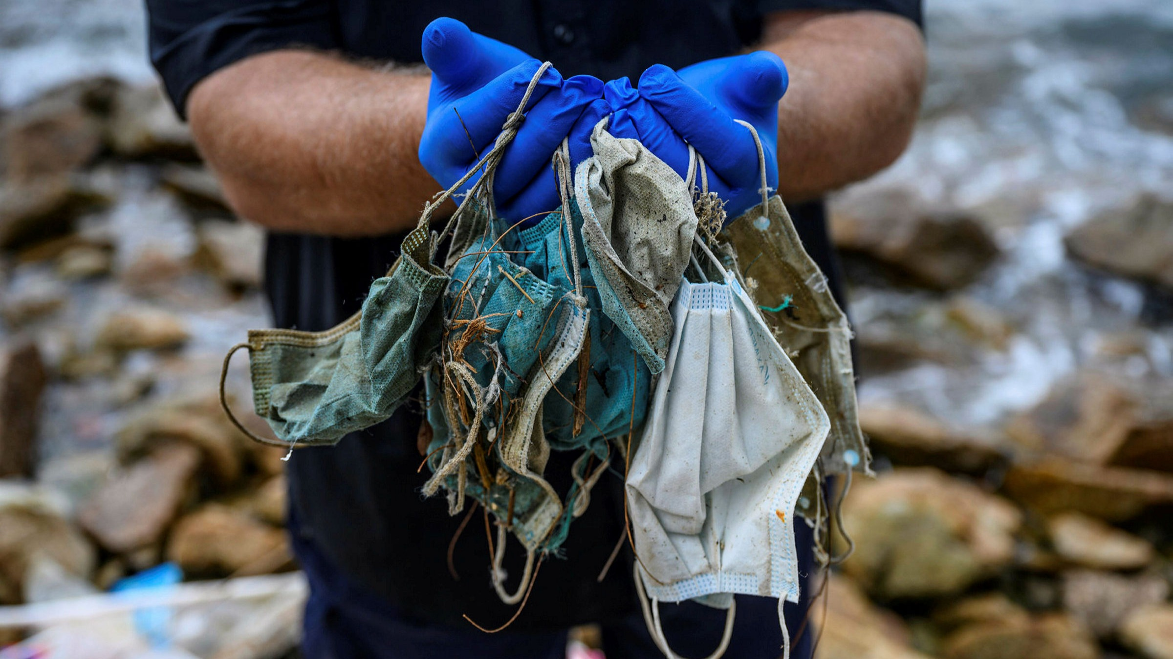 disposable masks and disposable gloves are being found in the sea